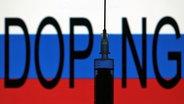 Die Flagge Russlandss mit Schriftzug Doping und Nadel einer Spritze © picture alliance Fotograf: Ralpg Peters